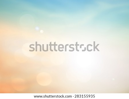 Blurry morning scene with orange field, sun burst, colorful blur sky. Summer holidays concept. - stock photo