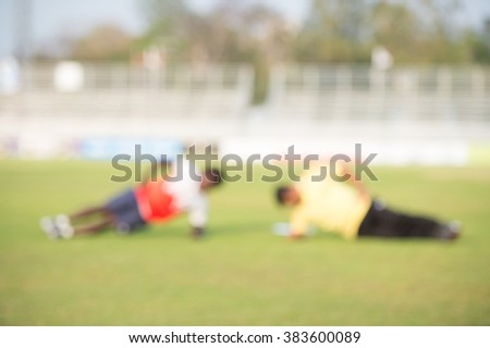 blurry,motion blur,Coach fitness in action playing football,Stretching (soccer) - stock photo