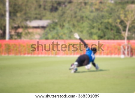 blurry,motion blur,Goalkeeper in action playing football,Save (soccer) - stock photo