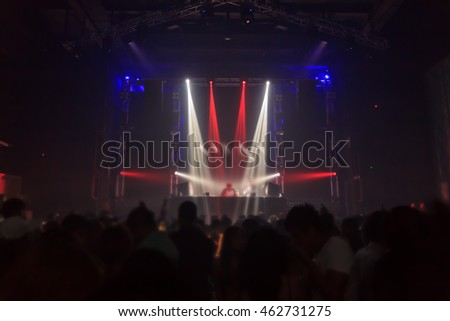 Blurry night club dj party people enjoy of music dancing sound with colorful light.