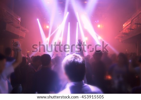 Blurry night club dj party people enjoy of music dancing sound with colorful light. club night light dj party bangkok RCA thailand.