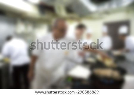 Blurry of Chef in hotel or restaurant kitchen cooking for dinner - stock photo