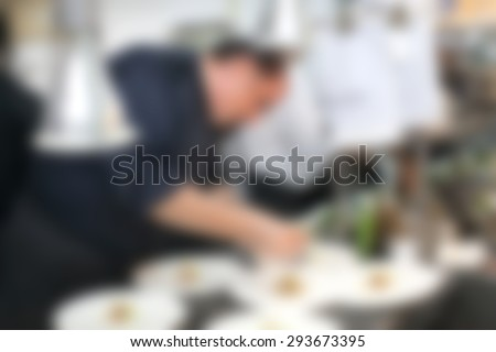 Blurry of Chef in hotel or restaurant kitchen cooking for party - stock photo