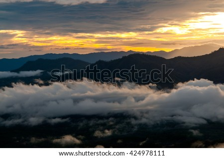 Blurry of sunrise with fog on the mountain.background - stock photo