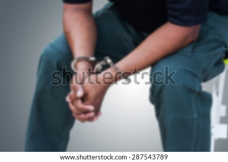 blurry of the man was bound by hand in the shackle out of freedom - stock photo