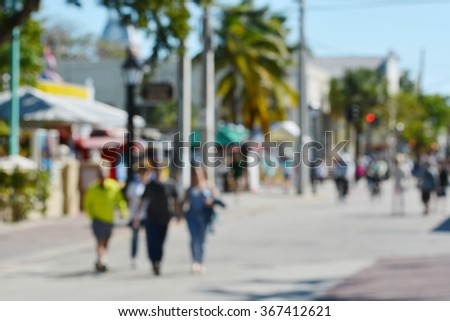 Blurry, out of focus abstract background of colorful outdoor street scene in Old Town, Key West, Florida. - stock photo