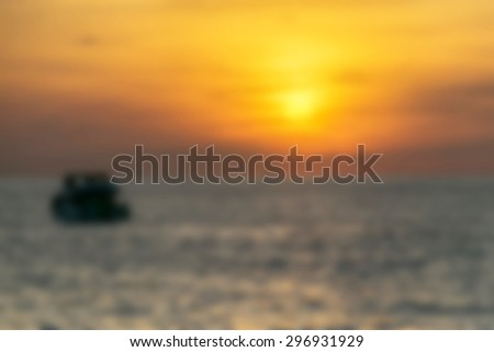 Blurry photos of Boats float in the sea during sunset. - stock photo