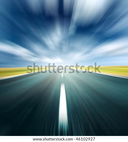 Blurry road and blurry sky with light and clouds
