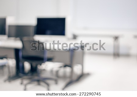 Blurry soft focus background of classroom with nobody with table, office chair, blackboard, concept of education, autumn, studying, copy space for text - stock photo