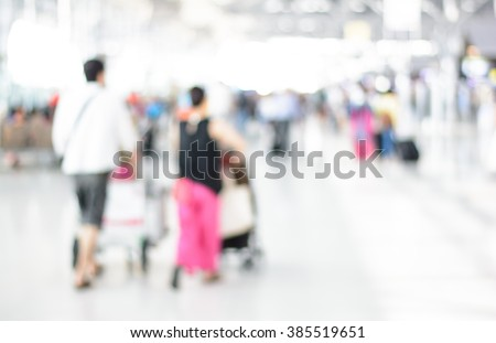 Blurry,Soft focus of the many people in terminal at the airport ready for travel and run a business with other country - stock photo