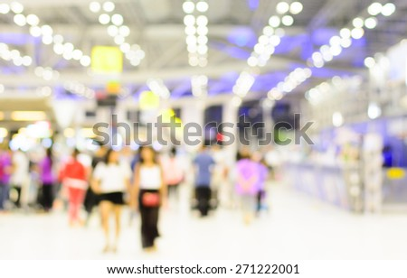 Blurry,Soft of the many people in terminal at the airport with bokeh of light on night time - stock photo
