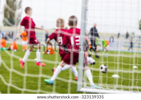 Blurry sport background of football soccer match. Training and game for children. - stock photo