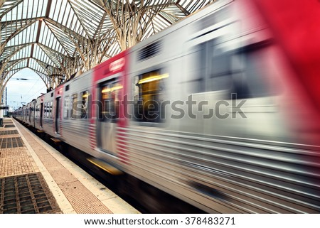 Blurry train going fast through Lisbon portugal Oriente Train Station - stock photo