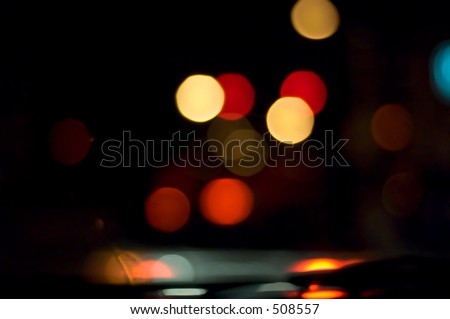 blurry vision while driving at night - stock photo