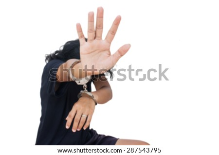 blurry women hand in handcuff  show  hand symbol stop ,Slave-Human Trafficking concept - stock photo