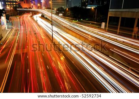 Blurs of night city traffic streams - stock photo