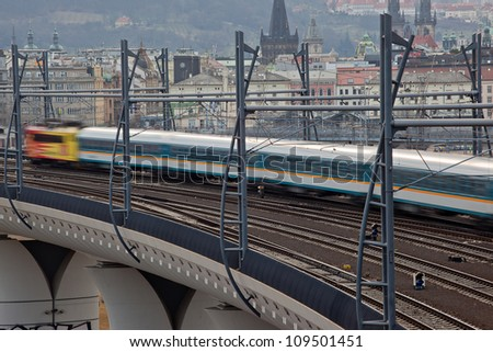 Blury fast train running elevated railway - stock photo