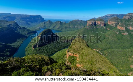 Blyde River Canyon and The Three Rondavels (Three Sisters) in Mpumalanga, South Africa. The Blyde River Canyon is the third largest canyon worldwide - stock photo