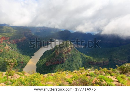 Blyde River Canyon - is a significant natural feature of South Africa, located in Mpumalanga, and forming the northern part of the Drakensberg escarpment. It is 25 kilometres in length - stock photo