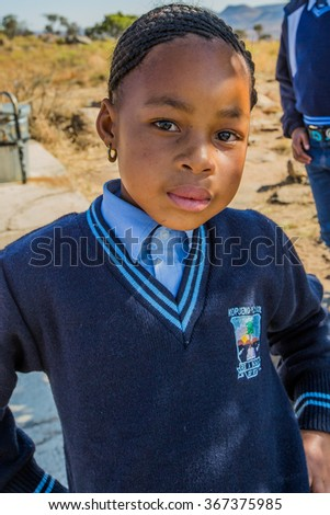 Blyde River Canyon Nature Reserve, South Africa - August 22, 2014: Portrait of a South African child girl in school uniform.