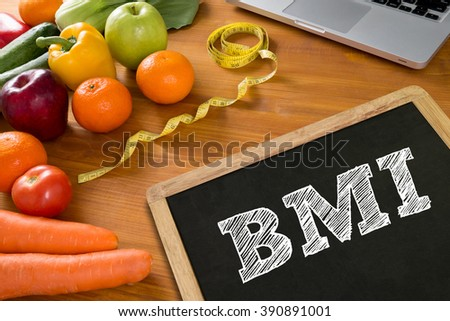 BMI body mass index formula rate formula in a board, fruit and tape measure on a wooden table, top view, Blank board copy space - stock photo