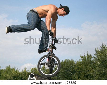bmx bike challenge (bikers in the sky) - stock photo