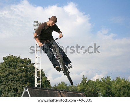 bmx bike challenge (bikers in the sky) - stock photo