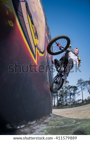 Bmx Bike Stunt Wall Ride on a skatepark.
