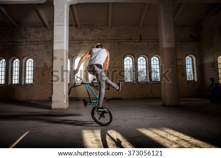 Bmx freestyle. A man on bmx doing tricks. - stock photo