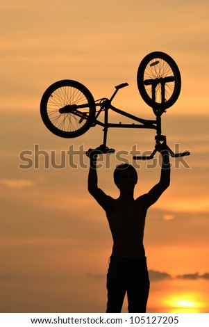 bmx rider action against sky at sunset.