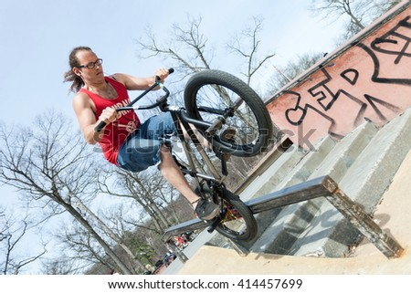 BMX Rider Doing Tricks - stock photo
