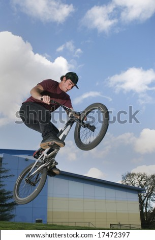 BMX Rider jumps with big air - stock photo