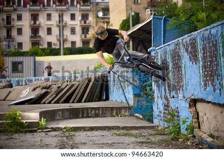 "BMX rider performing air trick ""wall-ride"" - stock photo"