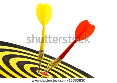 board close up with two darts in the middle over white - stock photo