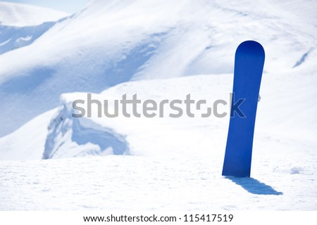 board for snowboarding in the snow on background snowy mountains of Europe - stock photo