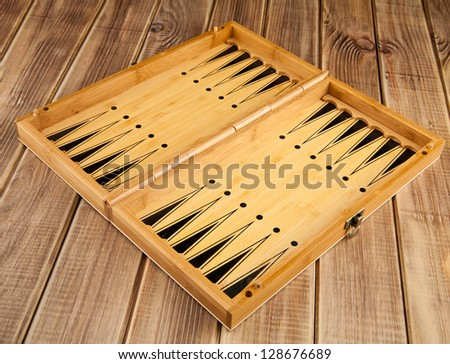 Board game of backgammon on a wooden table - stock photo