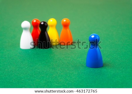 Board game pawns with one in a lead
