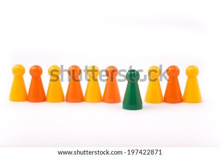Board game pieces - symbol for leadership or mobbing - stock photo