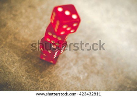 Board Games Leisure dice gambling Risk Chance red stacked background - stock photo