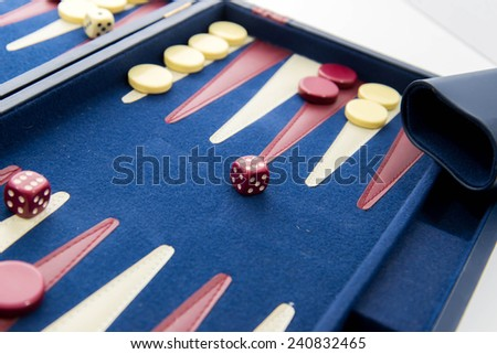 board games - red white and blue backgammon set in play - stock photo
