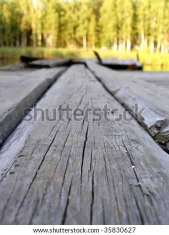 board of bridge on a lake close - stock photo