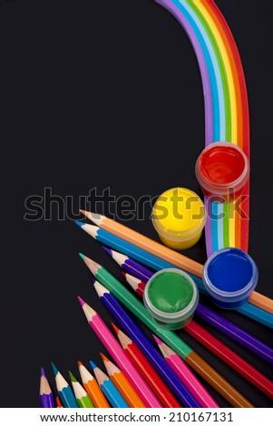 board, pencils,  lie on school desk  - stock photo