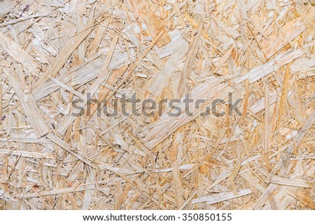 Board, plywood, wood pulp,PARTICLE BOARD,laminated wood shavings,Compressed light brown wooden texture - stock photo