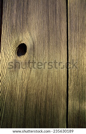 board with a hole after knot - stock photo