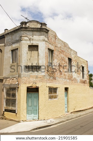 boarded up house sits next to a renovated terrace in Newtown, Sydney