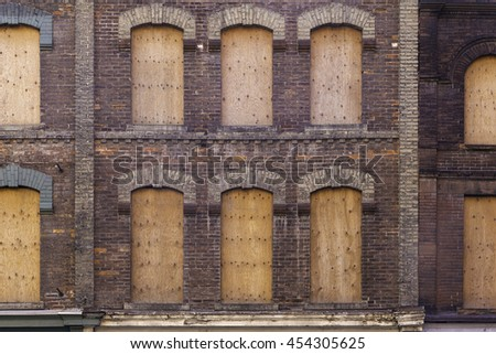 Boarded-up old building - stock photo