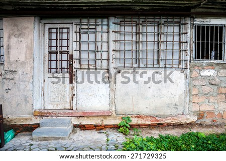 Boarded up window and old door of a old house - stock photo