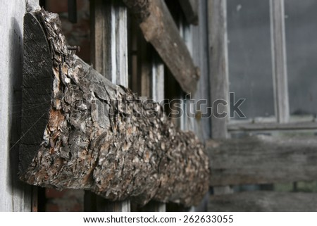 Boarded-up window in an abandoned old building. Shallow depth of field. - stock photo
