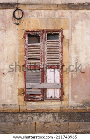Boarded up - Wooden window shutters of an old abandoned house in Sedan, France - stock photo
