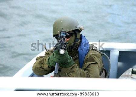 Boarding a ship – soldier. The Marine special forces to enter the ship to its search and hostage rescue – exercises. - stock photo